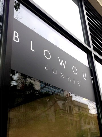 contact-blowout-junkie-window-sign